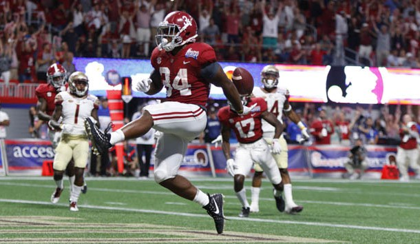 Sep 2, 2017; Atlanta, GA, USA;  Alabama Crimson Tide running back Damien Harris (34) scores a touchdown and celebrates in the third quarter against the Florida State Seminoles at Mercedes-Benz Stadium. Photo Credit: Brett Davis-USA TODAY Sports