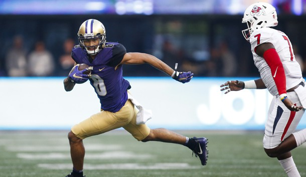 Sep 16, 2017; Seattle, WA, USA; Washington Huskies wide receiver Dante Pettis (8) runs for yardage after a catch against the Fresno State Bulldogs during the first quarter at Husky Stadium. Photo Credit: Joe Nicholson-USA TODAY Sports