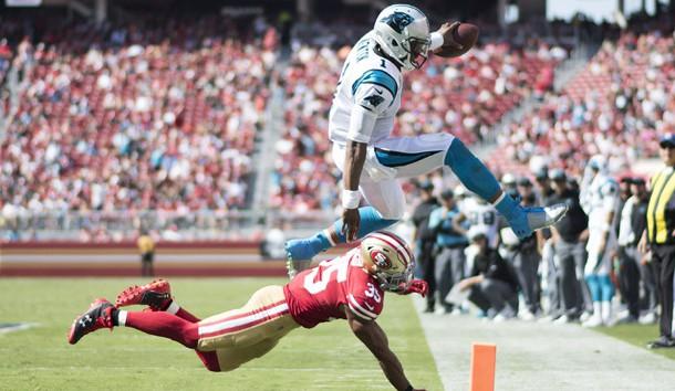 September 10, 2017; Santa Clara, CA, USA; Carolina Panthers quarterback Cam Newton (1) jumps over San Francisco 49ers free safety Eric Reid (35) during the third quarter at Levi's Stadium. The Panthers defeated the 49ers 23-3. Photo Credit: Kyle Terada-USA TODAY Sports