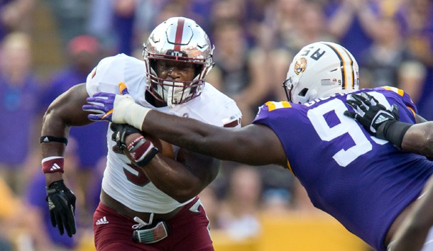 Sep 30, 2017; Baton Rouge, LA, USA; LSU Tigers nose tackle Greg Gilmore (99) tackles Troy Trojans running back Jordan Chunn (38) in the first quarter of the game between the LSU Tigers and the Troy Trojans at Tiger Stadium. Photo Credit: Stephen Lew-USA TODAY Sports
