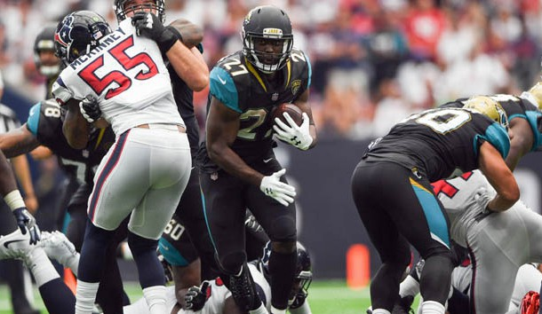 Sep 10, 2017; Houston, TX, USA; Jacksonville Jaguars running back Leonard Fournette (27) runs the ball around Houston Texans defense during the third quarter at NRG Stadium. Photo Credit: Shanna Lockwood-USA TODAY Sports