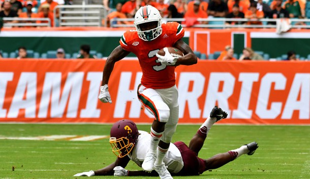 Sep 2, 2017; Miami Gardens, FL, USA; Miami Hurricanes wide receiver Mike Harley (3) runs past Bethune Cookman Wildcats cornerback Jamaal Burgess (3) during the first half at Hard Rock Stadium. Photo Credit: Steve Mitchell-USA TODAY Sports
