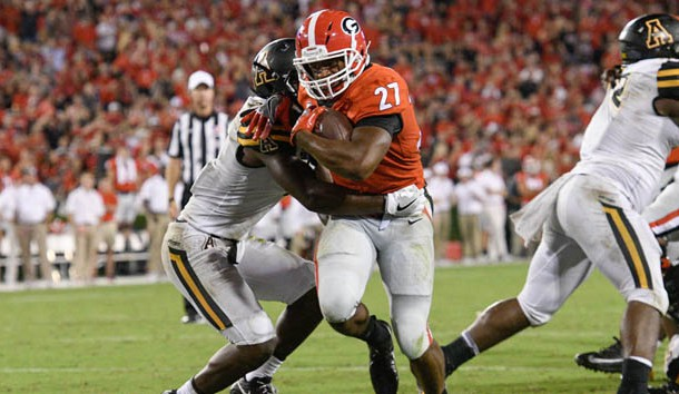 Sep 2, 2017; Athens, GA, USA; Georgia Bulldogs running back Nick Chubb (27) breaks a tackle by Appalachian State Mountaineers defensive back Josh Thomas (7) to score a touchdown during the second half at Sanford Stadium. Photo Credit: Dale Zanine-USA TODAY Sports
