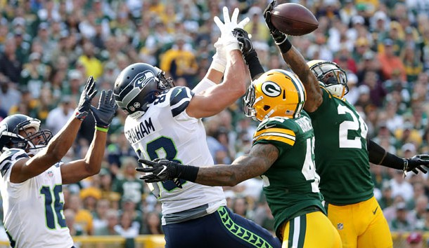Sep 10, 2017; Green Bay, WI, USA; Green Bay Packers players Quinten Rollins and Morgan Burnett defend a pass in the end zone that was intended for Seattle Seahawks player Jimmy Graham in a NFL game at Lambeau Field. Photo Credit: William Glasheen/The Post-Crescent via USA TODAY Sports