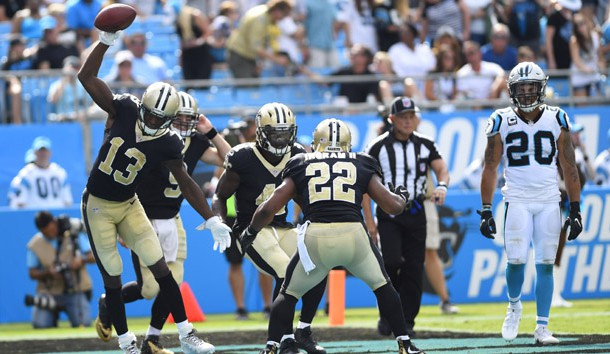 Sep 24, 2017; Charlotte, NC, USA; New Orleans Saints running back Alvin Kamara (41) celebrates with wide receiver Michael Thomas (13), quarterback Drew Brees (9) and running back Mark Ingram (22) after scoring a touchdown in the fourth quarter at Bank of America Stadium. Photo Credit: Bob Donnan-USA TODAY Sports