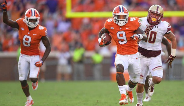 Sep 23, 2017; Clemson, SC, USA;  Clemson running back Travis Etienne (9) runs 50 yards to score against Boston College during the 4th quarter at Clemson Memorial Stadium. Photo Credit: Bart Boatwright/Greenville News via USA TODAY Sports