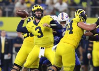 Michigan's Harbaugh sticking with Speight