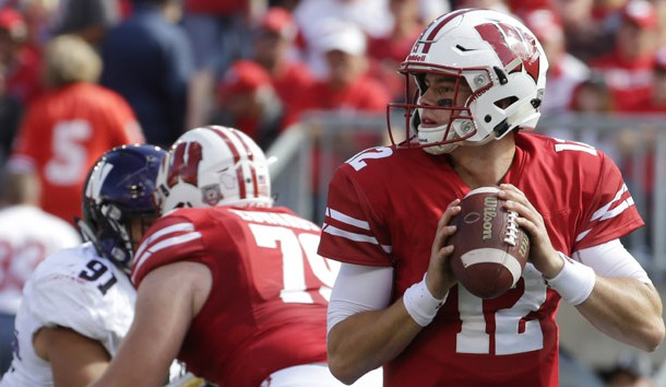 Sep 30, 2017; Madison, WI, USA;   Wisconsin quarterback Alex Hornibrook (12) looks for an open receiver during the first quarter of their game at Camp Randall Stadium. Wisconsin beat Northwestern 33-24.  Photo Credit: Mark Hoffman/Milwaukee Journal Sentinel via USA TODAY Sports