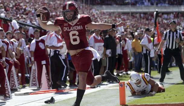 Oct 7, 2017; Norman, OK, USA; Oklahoma Sooners quarterback Baker Mayfield (6) scores a touchdown in front of Iowa State Cyclones linebacker Joel Lanning (7) during the second quarter at Gaylord Family - Oklahoma Memorial Stadium. Photo Credit: Mark D. Smith-USA TODAY Sports