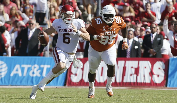 Oct 14, 2017; Dallas, TX, USA; Oklahoma Sooners quarterback Baker Mayfield (6) runs the ball against Texas Longhorns defensive lineman Poona Ford (95) in the first quarter at the Cotton Bowl. Photo Credit: Tim Heitman-USA TODAY Sports