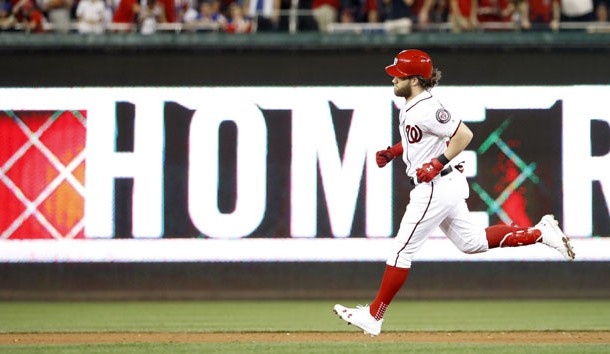 Oct 7, 2017; Washington, DC, USA; Washington Nationals right fielder Bryce Harper (34) hits a 2-RBI home run during the eighth inning in game two of the 2017 NLDS against the Chicago Cubs at Nationals Park. Photo Credit: Geoff Burke-USA TODAY Sports