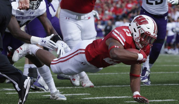 Sep 30, 2017; Madison, WI, USA; Wisconsin running back Jonathan Taylor (23) scores a touchdown on a seven yard run during the first quarter of their game against Northwestern at Camp Randall Stadium.   Photo Credit: Mark Hoffman/Milwaukee Journal Sentinel via USA TODAY Sports