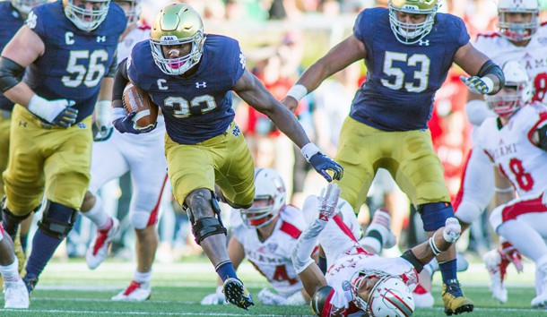 Sep 30, 2017; South Bend, IN, USA; Notre Dame Fighting Irish running back Josh Adams (33) runs the ball in the first quarter of the game against the Miami (Oh) Redhawks at Notre Dame Stadium. Photo Credit: Trevor Ruszkowski-USA TODAY Sports