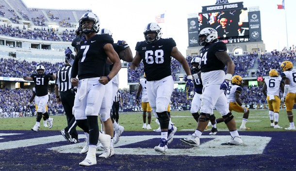 Oct 7, 2017; Fort Worth, TX, USA; TCU Horned Frogs quarterback Kenny Hill (7) celebrates with teammates after scoring the game-winning touchdown during the fourth quarter against the West Virginia Mountaineers at Amon G. Carter Stadium. Photo Credit: Kevin Jairaj-USA TODAY Sports