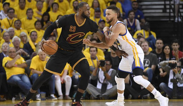 Jun 12, 2017; Oakland, CA, USA; Cleveland Cavaliers forward LeBron James (23) is defended by Golden State Warriors guard Stephen Curry (30) during the third quarter in game five of the 2017 NBA Finals at Oracle Arena. Photo Credit: Kyle Terada-USA TODAY Sports