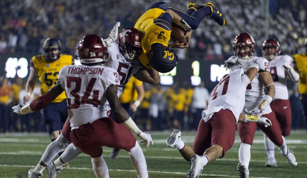 Oct 13, 2017; Berkeley, CA, USA; California Golden Bears quarterback Ross Bowers (3) leaps for a touchdown against Washington State Cougars linebacker Justus Rogers (37) during the second half at Memorial Stadium. Photo Credit: Neville E. Guard-USA TODAY Sports