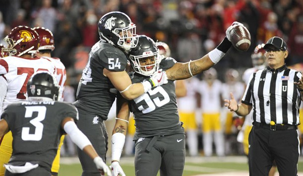 Sep 29, 2017; Pullman, WA, USA; Washington State Cougars linebacker Nate DeRider (54) and Washington State Cougars linebacker Derek Moore (55) celebrate a turnover against the USC Trojans during the second half at Martin Stadium. The Cougars won 30-27. Photo Credit: James Snook-USA TODAY Sports
