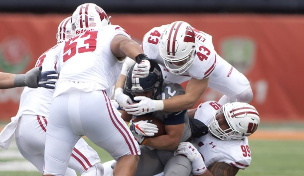 Oct 28, 2017; Champaign, IL, USA; Illinois Fighting Illini running back Kendrick Foster (22) is tackled by Wisconsin Badgers linebacker Ryan Connelly (43) and  nose tackle Olive Sagapolu (99) during the fourth quarter at Memorial Stadium. Photo Credit: Mike Granse-USA TODAY Sports
