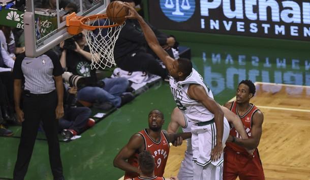Nov 12, 2017; Boston, MA, USA; Boston Celtics forward Al Horford (42) dunks the ball past Toronto Raptors guard DeMar DeRozan (10) during the first half at TD Garden. Photo Credit: Bob DeChiara-USA TODAY Sports