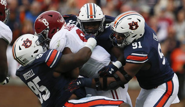 Nov 25, 2017; Auburn, AL, USA; Alabama Crimson Tide running back Josh Jacobs (8) is brought down by Auburn Tigers defensive lineman Dontavius Russell (95) and defensive lineman Nick Coe (91) during the second quarter at Jordan-Hare Stadium. Photo Credit: John Reed-USA TODAY Sports