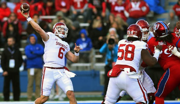 Nov 18, 2017; Lawrence, KS, USA; Oklahoma Sooners quarterback Baker Mayfield (6) throws a pass against the Kansas Jayhawks in the first half at Memorial Stadium. Photo Credit: Jay Biggerstaff-USA TODAY Sports