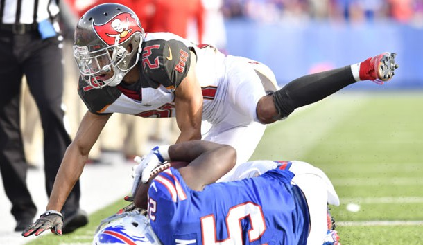 Oct 22, 2017; Orchard Park, NY, USA; Tampa Bay Buccaneers cornerback Brent Grimes (24) makes a tackle on Buffalo Bills running back LeSean McCoy (25) during the fourth quarter of a game at New Era Field. Photo Credit: Mark Konezny-USA TODAY Sports