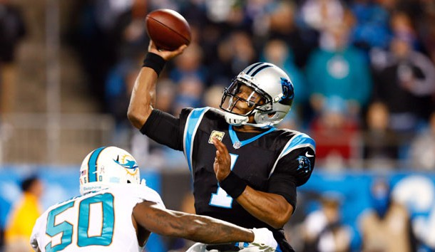 Nov 13, 2017; Charlotte, NC, USA; Carolina Panthers quarterback Cam Newton (1) passes the ball while under pressure by Miami Dolphins defensive end Andre Branch (50) in the first quarter at Bank of America Stadium. Photo Credit: Jeremy Brevard-USA TODAY Sports