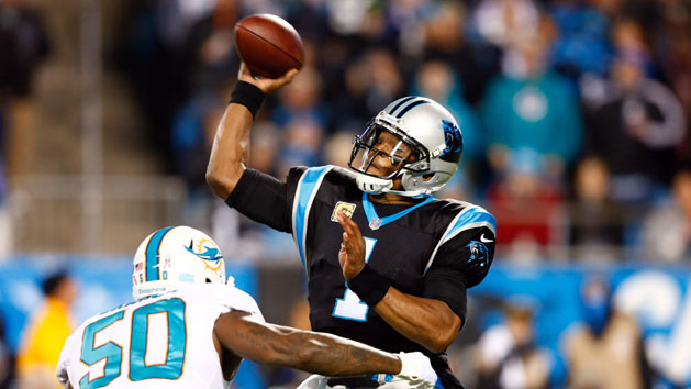 Panthers maul Fins behind Newton's 4 TD passes