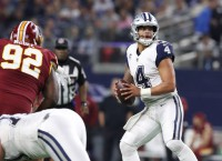 Prescott shakes off injury as Cowboys rout Redskins