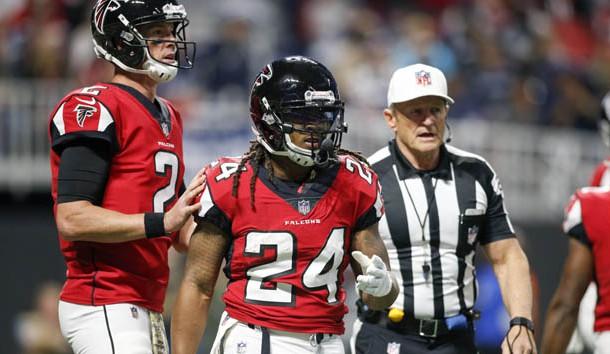 Nov 12, 2017; Atlanta, GA, USA; Atlanta Falcons running back Devonta Freeman (24) is sent off the field with an injury by referee Ed Hochuli against the Dallas Cowboys in the first quarter at Mercedes-Benz Stadium. Photo Credit: Brett Davis-USA TODAY Sports