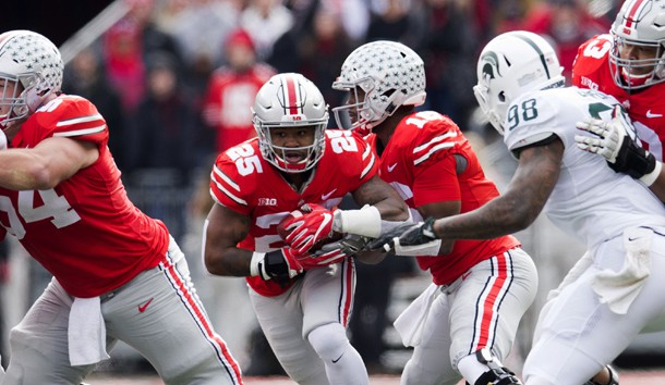 Nov 11, 2017; Columbus, OH, USA; Ohio State Buckeyes running back Mike Weber (25) takes a handoff from quarterback J.T. Barrett (16) and breaks a long run for the first touchdown of the game against the Michigan State Spartans at Ohio Stadium. Photo Credit: Greg Bartram-USA TODAY Sports