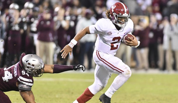 Nov 11, 2017; Starkville, MS, USA; Alabama Crimson Tide quarterback Jalen Hurts (2) runs the ball past Mississippi State Bulldogs defensive lineman Jeffery Simmons (94) during the fourth quarter at Davis Wade Stadium. Photo Credit: Matt Bush-USA TODAY Sports