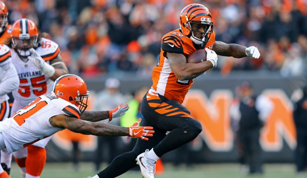Nov 26, 2017; Cincinnati, OH, USA; Cincinnati Bengals running back Joe Mixon (28) avoids a tackle from Cleveland Browns cornerback Jamar Taylor (21) in the second half at Paul Brown Stadium. Photo Credit: Aaron Doster-USA TODAY Sports