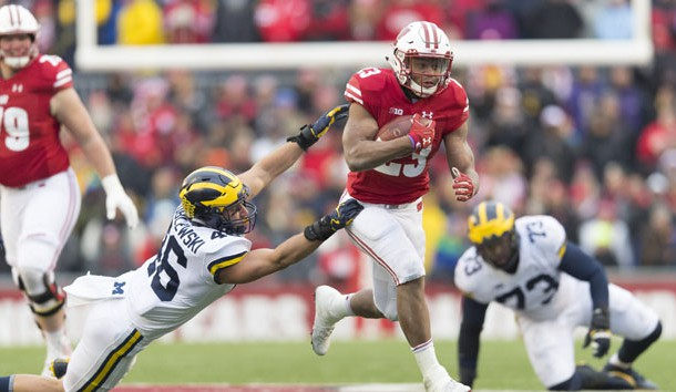 Jonathan Taylor (23) rushes with the football during the fourth quarter against the Michigan Wolverines at Camp Randall Stadium last season. Photo Credit: Jeff Hanisch-USA TODAY Sports