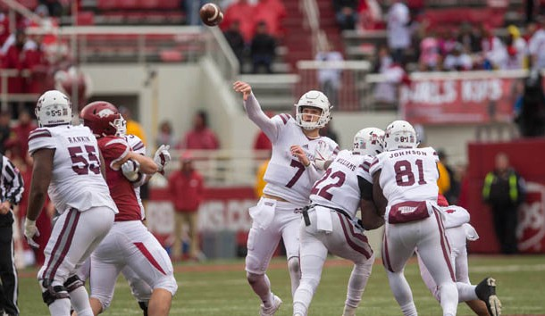 Nov 18, 2017; Fayetteville, AR, USA; Mississippi State Bulldogs quarterback Nick Fitzgerald (7) throws a pass for an eventual touchdown during the fourth quarter of the game against the Arkansas Razorbacks at Donald W. Reynolds Razorback Stadium. Mississippi State Bulldogs won 28-21. Photo Credit: Brett Rojo-USA TODAY Sports