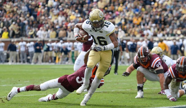 Nov 11, 2017; Atlanta, GA, USA; Georgia Tech Yellow Jackets quarterback TaQuon Marshall (16) breaks a tackle by Virginia Tech Hokies cornerback Greg Stroman (3) to score a touchdown during the first quarter at Bobby Dodd Stadium. Photo Credit: Dale Zanine-USA TODAY Sports