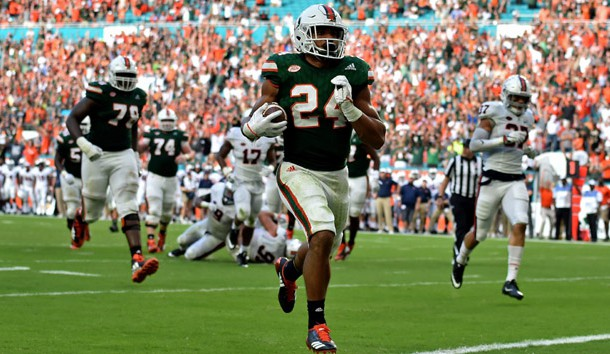 Nov 18, 2017; Miami Gardens, FL, USA; Miami Hurricanes running back Travis Homer (24) scores a touchdown during the second half against Virginia Cavaliers at Hard Rock Stadium. Photo Credit: Steve Mitchell-USA TODAY Sports