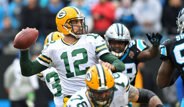 Dec 17, 2017; Charlotte, NC, USA; Green Bay Packers quarterback Aaron Rodgers (12) looks to pass as Carolina Panthers outside linebacker Thomas Davis (58) pressures in the fourth quarter at Bank of America Stadium. Photo Credit: Bob Donnan-USA TODAY Sports