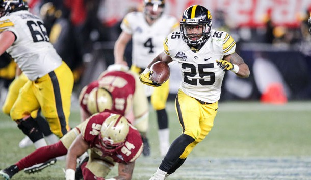 Dec 27, 2017; Bronx, NY, USA; Iowa Hawkeyes running back Akrum Wadley (25) rushes against Boston College Eagles defensive tackle Noa Merritt (94) during the second half of the 2017 Pinstripe Bowl at Yankee Stadium. Photo Credit: Vincent Carchietta-USA TODAY Sports