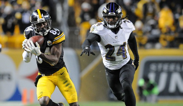 Dec 10, 2017; Pittsburgh, PA, USA; Pittsburgh Steelers wide receiver Antonio Brown (84) catches a pass for a first down in the fourth quarter as Baltimore Ravens cornerback Brandon Carr (24) gives chase at Heinz Field. The play set up a Steelers touchdown as they went on to win 39-38.    Photo Credit: Philip G. Pavely-USA TODAY Sports