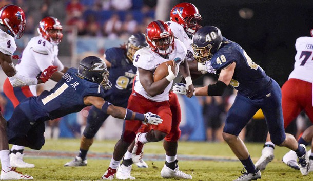 Dec 19, 2017; Boca Raton, FL, USA; Florida Atlantic Owls running back Devin Singletary (5) carries the ball against Akron Zips cornerback Alvin Davis (1) in the 2017 Boca Raton Bowlagainst the Akron Zips  at FAU Stadium. Photo Credit: Steve Mitchell-USA TODAY Sports