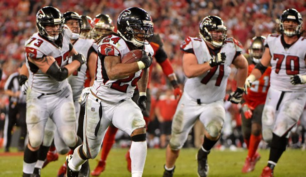 Dec 18, 2017; Tampa, FL, USA; Atlanta Falcons running back Devonta Freeman (24) runs the ball for a touchdown against the Tampa Bay Buccaneers during the second half at Raymond James Stadium. Photo Credit: Jasen Vinlove-USA TODAY Sports