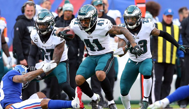 Dec 17, 2017; East Rutherford, NJ, USA; Philadelphia Eagles corner back Ronald Darby (41) runs back an interception against New York Giants wide receiver Roger Lewis (18) during the second quarter at MetLife Stadium. Photo USA TODAY Sports
