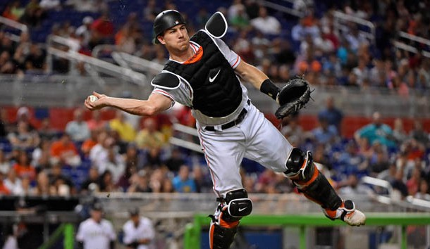 Sep 28, 2017; Miami, FL, USA; Miami Marlins catcher J.T. Realmuto (11) throws the ball to first base for an out in the third inning against the Atlanta Braves at Marlins Park. Photo Credit: Jasen Vinlove-USA TODAY Sports