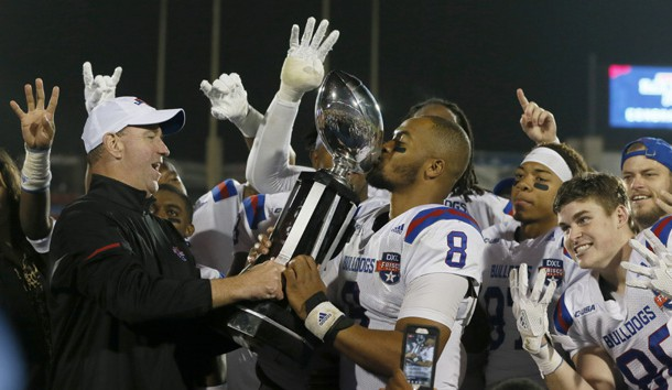 Dec 20, 2017; Frisco, TX, United States; Louisiana Tech Bulldogs quarterback J'Mar Smith (8) kisses the trophy after the game against the Southern Methodist Mustangs in the 2017 Frisco Bowl at Toyota Stadium. Photo Credit: Tim Heitman-USA TODAY Sports