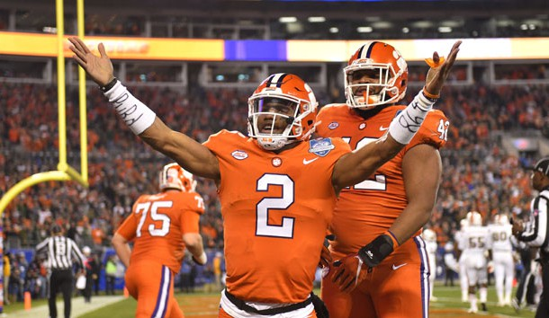 Dec 2, 2017; Charlotte, NC, USA; Clemson Tigers quarterback Kelly Bryant (2) celebrates with defensive lineman Christian Wilkins (42) after scoring a touchdown a touchdown in the first quarter in the ACC championship game at Bank of America Stadium. Photo Credit: Bob Donnan-USA TODAY Sports