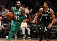 Celtics' Irving out with quad injury