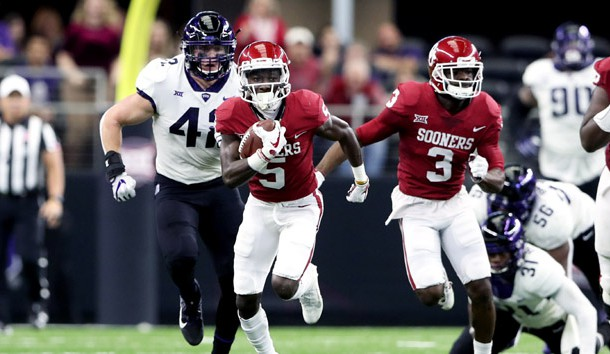 Dec 2, 2017; Arlington, TX, USA; Oklahoma Sooners wide receiver Marquise Brown (5) runs with the ball during the first quarter against the TCU Horned Frogs in the Big 12 Championship game at AT&;T Stadium. Photo Credit: Kevin Jairaj-USA TODAY Sports