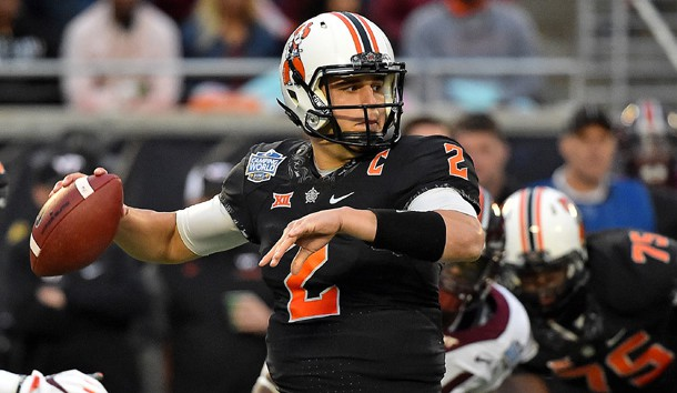 Dec 28, 2017; Orlando, FL, USA; Oklahoma State Cowboys quarterback Mason Rudolph (2) attempts a pass against the Virginia Tech Hokies during the first half in the 2017 Camping World Bowl at Camping World Stadium. Photo Credit: Jasen Vinlove-USA TODAY Sports