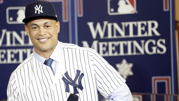 It's official: Stanton joins Judge in pinstripes